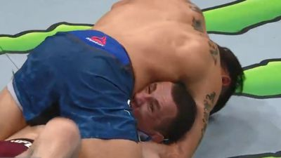 UFC fighter is choked at UFC Atlantic City until his face turns blue