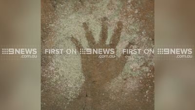 Ancient handprints and drawings have been found in a rock shelter 100m from suburban homes in Sydney. (9NEWS)