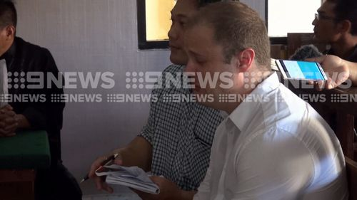 Isaac Roberts, 35, broke down in Denpasar District Court recounting the death of his partner Donwill Lloyd Lim last week. (9NEWS)