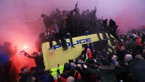A 53-year-old Reds supporter was allegedly attacked with a belt by Roma fans who had used a side road to enter an area where Liverpool fans were gathering. Picture: AAP.