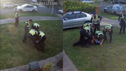 CCTV shows the officers pinning the man down and repeatedly striking him with a baton. (Fairfax Media)