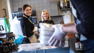 Sweden's Crown Princess Victoria volunteers to pack boxes at Stockholm City Mission foodbank