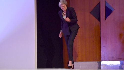 The first signs of the dance as Theresa May walks on stage.