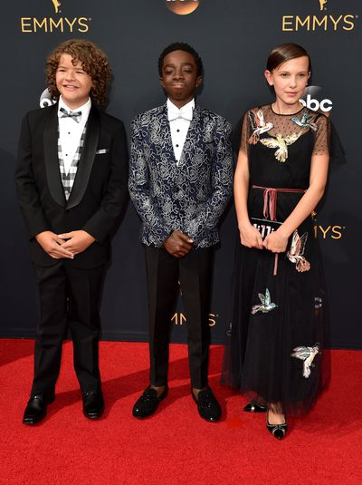 3. Bobby Brown, Valentino Red dress, Edie Parker bag and Nicholas Kirkwood shoes. With Gaten Matarazzo and Caleb McLaughlin.