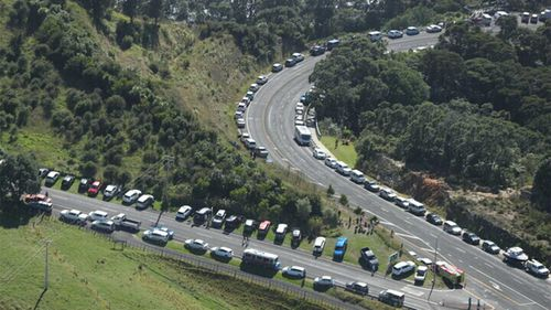 Cars parked beside the roads on higher ground as New Zealanders await a potential tsunami.