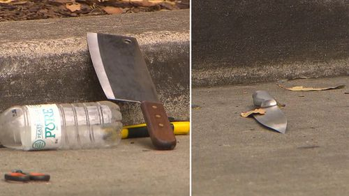 Three weapons were found in a nearby carpark. (9NEWS)