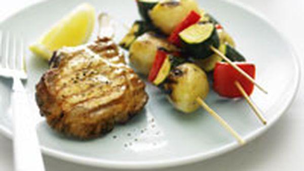 Pork cutlets with glazed vegetable kebabs