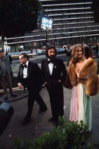 Record producer Lou Adler and Lauren Hutton in Halston at the 1975 Academy Awards