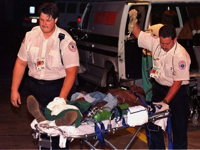 A victim of the Olympic Centennial Park bombing is rushed to Georgia Baptist Hospital by emergency medical officers, early July 27. Two people have been reported killed as a result of the bombing with over fifty injured.