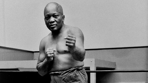 In this 1932 file photo, boxer Jack Johnson, the first black world heavyweight champion, poses in New York City. Black athletes have been finding a way to fight for social change for more than 100 years, from Jack Johnson, to Muhammad Ali to Kaepernick. (AP Photo/File)