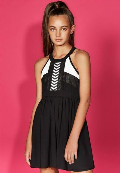 "<a href=""https://www.bardot.com/bardotjunior/merchandising-1/by-category/girls-1/tweengirls-age-8-16-1/dresses-3/shimmer-aztec-dress-1"" target=""_blank"" draggable=""false"">Bardot Junior Girls Shimmer Aztec Dress, $69.99.</a>"