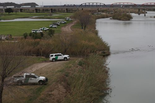 Law Enforcement and Border Patrol line the banks.