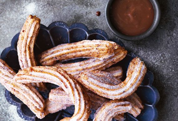 Annie Rigg's orange-scented churros with caramel orange chocolate sauce