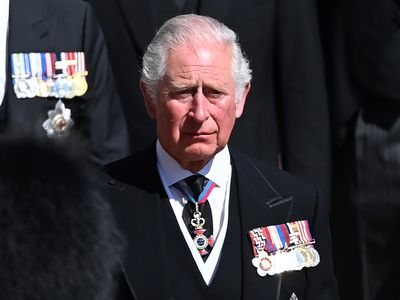 Prince Charles sheds tears as he walks behind his father's coffin