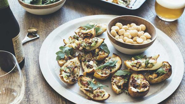 Roasted potato skins with macadamias, bacon, rocket and blue c