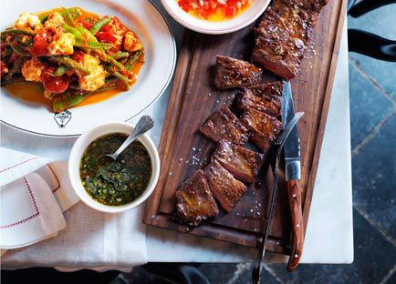 Char-grilled skirt steak and beef short ribs with salsa Criolla and chimichurri