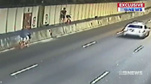 Two Sydney cyclists have been caught on CCTV riding through the CBD's Eastern Distributor tunnel without helmets.