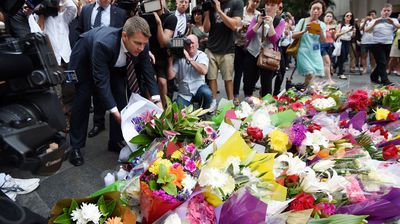 NSW Premier Mike Baird lays flowers at the memorial. (AAP)