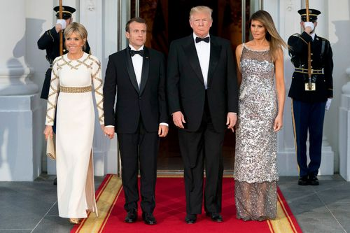 Trump, first lady Melania Trump, French President Emmanuel Macron and his wife Brigitte Macron, pose for photographs as they arrive for a State Dinner at the White House in Washington.