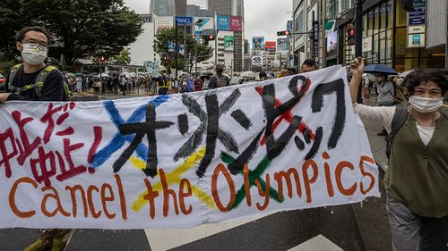 Protesters march through Shinjuku area during a protest against the Tokyo 2020 Olympic Games.