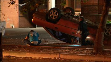 Driver flips his car in school car park during police pursuit