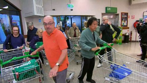 Elderly and disabled members of the community arrive at Woolworths for their dedicated shopping hour.