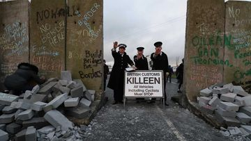 Actors pose as border police at a protest in Carrickcarnan on the Ireland border.