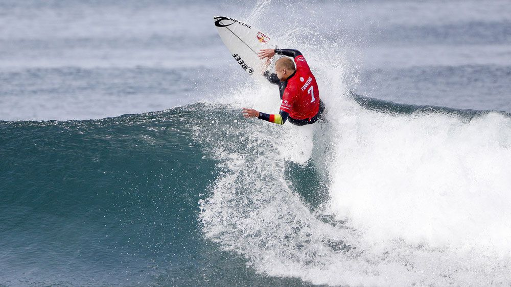 Mick Fanning ousts Kelly Slater in battle between surfing royalty at Bells Beach