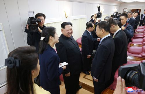 Kim Jong-un and his delegation chatted wit the Chinese on pink leather chairs. Picture: