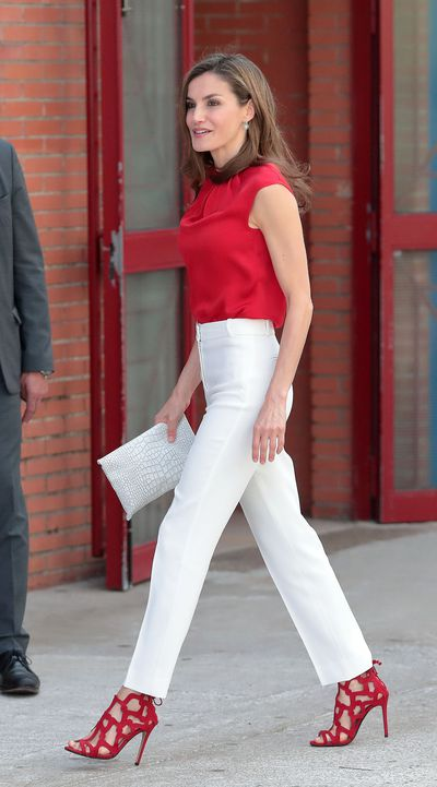 <p>The Spanish royal visited local schools in Aviles, Spain  in what can only be described as a striking candy-cane concoction. Letizia paired her red silk shirt with fitted white trousers and bright-red Mango heels.</p>