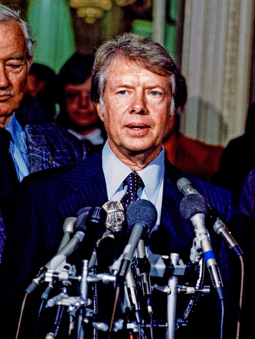 United States President-elect Jimmy Carter meets reporters after meeting with Congressional leaders in the US Capitol in Washington, DC on November 23, 1976