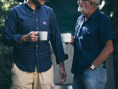 Father and son with coffee cup