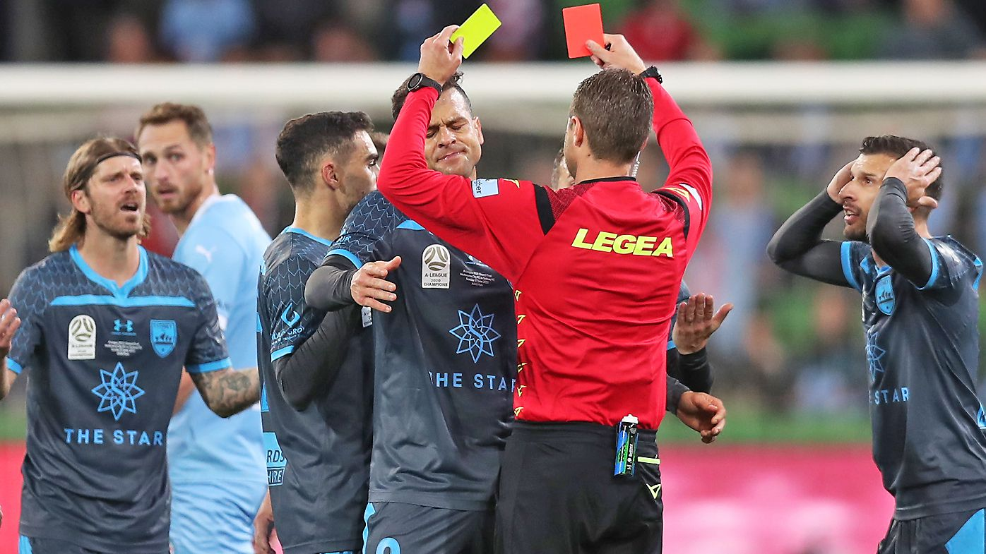 Luke Brattan of Sydney FC is given a red card during the A-League Grand Final