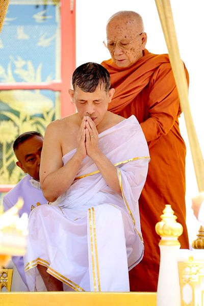 King Maha Vajiralongkorn Bodindradebayavarangkun offers prayer during the royal purification ablution bath as part of his coronation ceremony at the Grand Palace in Bangkok, Thailand. This is a formal ceremony to complete the monarch's accession to the throne.