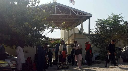 Patients are evacuated from the Red Cross hospital, following an attack on a Spanish physiotherapist allegedly by two patients, at the clinical facility, in Mazar-e-Sharif. (AAP)