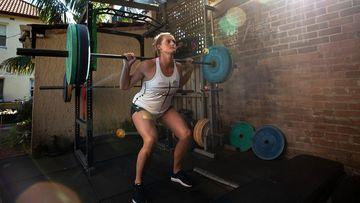 Australian rower Georgie Rowe trains in isolation in a backyard gym in Sydney, Australia.
