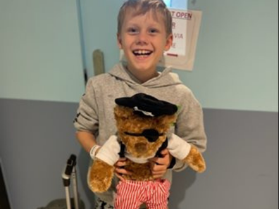 Eli with his Kids' Cancer Project bear