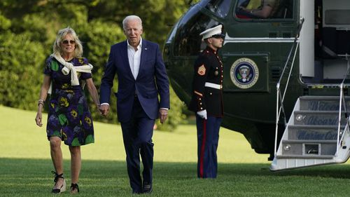 President Joe Biden and first lady Jill Biden walk on the South Lawn of the White House after stepping off Marine One on June 27 in Washington.