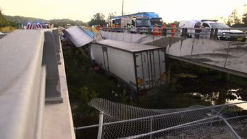The truck had veered into a creek dividing the north and southbound lanes of the Pacific Highway at Raleigh.