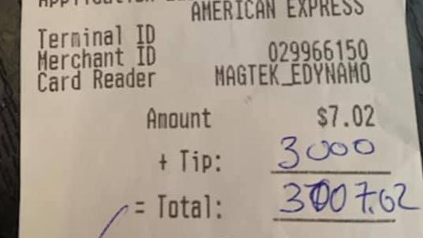 Restaurant receipt with $3000 tip
