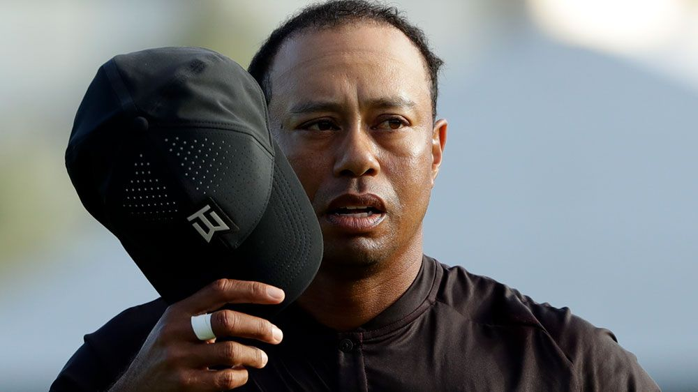 Day hot, Tiger makes cut at Torrey Pines