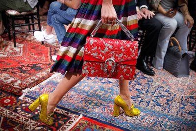 """<p>If there's one takeaway from Gucci Cruise, it's that more is more when it comes to accessories. A line-up of metallic loafers, bejewelled headbands, floral print purses, cat-eye glasses and cascading earrings will have you rethinking Coco Chanel's """"Always remove one thing before you leave the house"""" rule.</p>"""