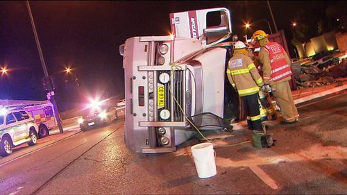 A B-double truck has rolled over on a busy Adelaide intersection. Picture: 9NEWS