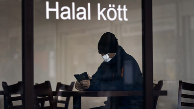 A man sits at a restaurant in Rinkeby district, Rinkeby-Kista borough in Stockholm, Sweden, Tuesday, April 28, 2020.