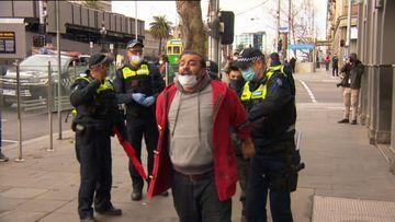 Seven arrests, dozens fined at Melbourne anti-mask protest