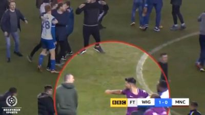 Manchester City Sergio Aguero clashes with fan after FA Cup loss to Wigan
