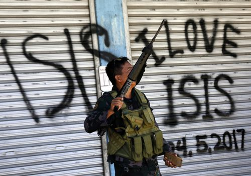 A Filipino government soldier conducts a patrol on a reclaimed former Maute stronghold in Marawi City, Mindanao, in a photo dated May 2017.