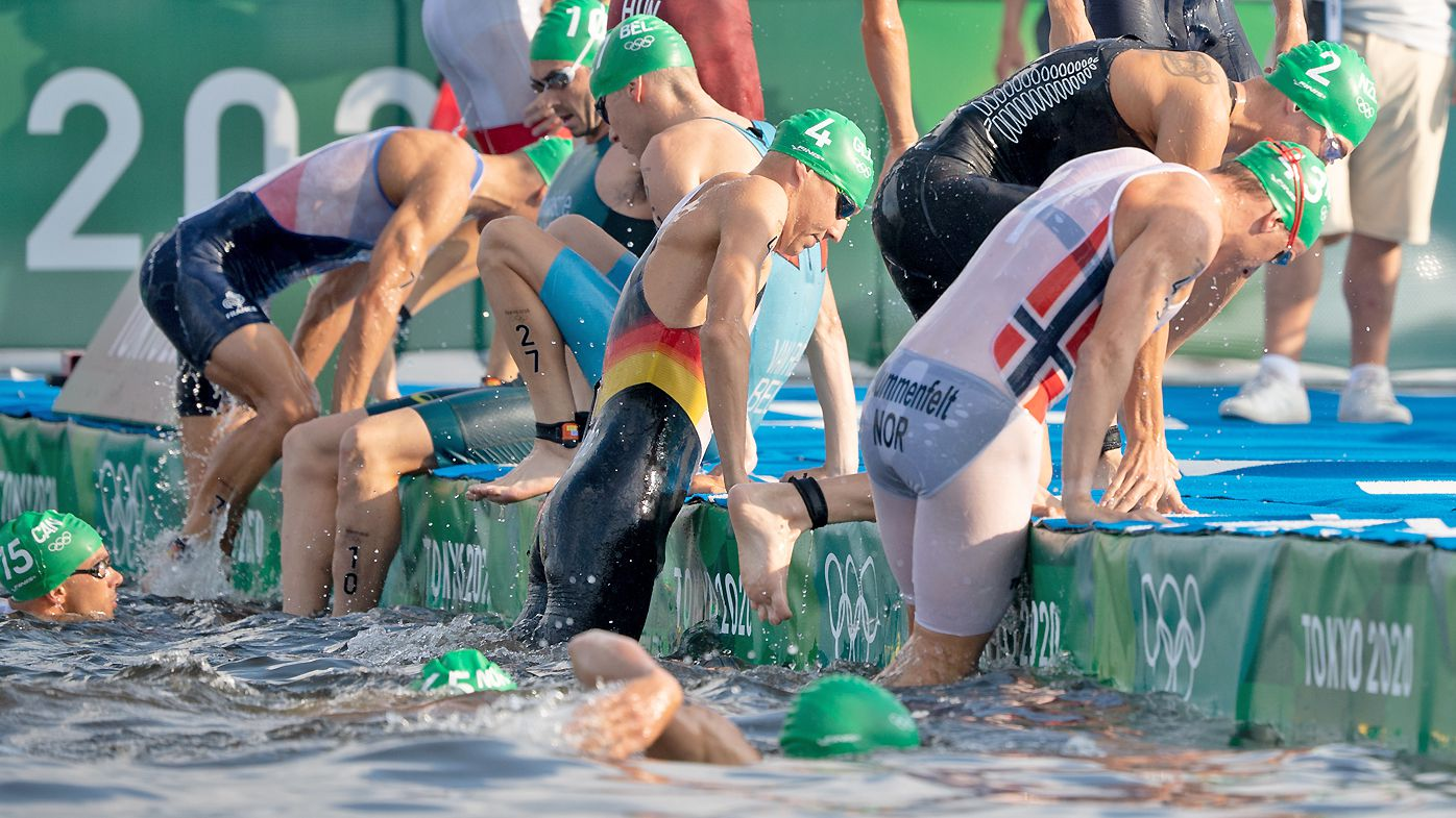 A false start forces triathletes out of the water