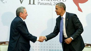 Mr Obama with Cuban counterpart Raul Castro. (AAP)