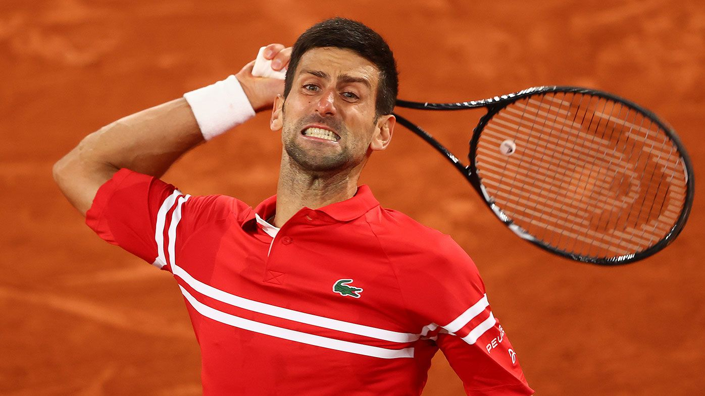 Novak Djokovic of Serbia celebrates match point and victory during his Mens Singles Quarter-Final match against Matteo Berrettini of Italy at Roland-Garros.